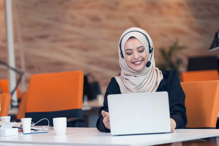 Arabic business woman wearing hijab,working in startup office.