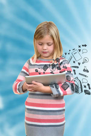 little standing girl with tablet with icons on screen. Stock Photo