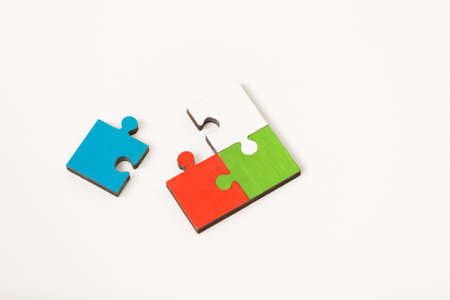 love strategy: business people group assembling jigsaw puzzle and represent team support Stock Photo