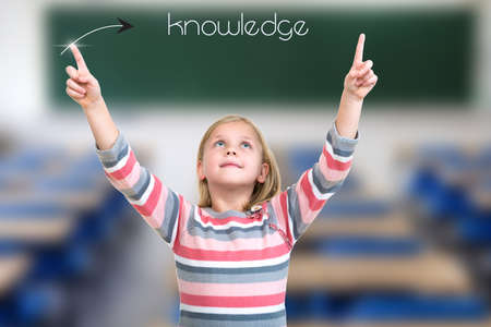 Little girl pointing on knowledge sign with hand