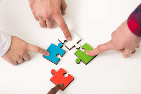 represent: business people group assembling jigsaw puzzle and represent team support Stock Photo