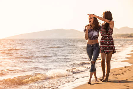 Pretty girl has a fun with her girlfriend on the beach Stock Photo - 70509634