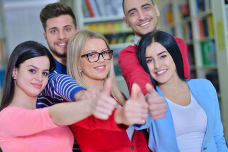 application university: Cheerful group of students smiling at camera with thumbs up, success and learning concept