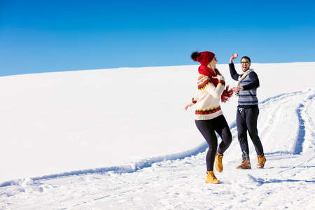ski walking: Couple having fun running down slope Stock Photo