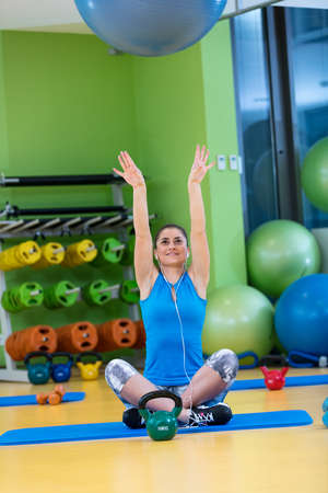 laying abs exercise: fitness, sport, training, gym and lifestyle concept - young woman doing exercise on fitness ball