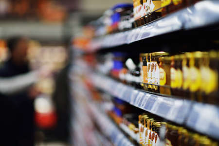 Woman shopping dairy product in grocery store Standard-Bild