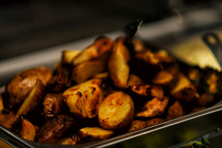 pancetta cubetti: Fried potatoes with bacon and onions in pot
