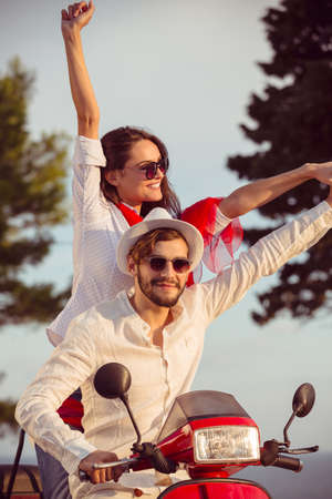 Couple in love riding a motorbike , Handsome guy and young sexy woman travel .