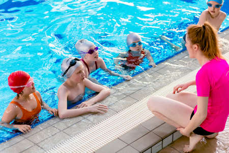 happy children kids group at swimming pool class learning to swim Stock Photo - 77681432