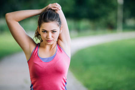 Woman is stretching before jogging. Fitness and lifestyle concept.