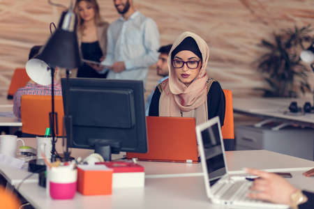 Young Arabic business woman wearing hijab,working in her startup office.