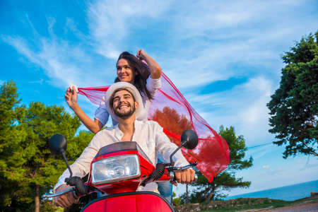 Happy free freedom couple driving scooter excited on summer holidays  vacation. fbfca201944