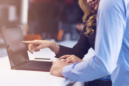 openspace: Young couple working together on a laptop in the office. Teamwork concepts Stock Photo