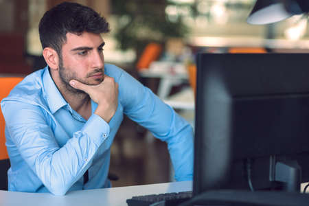 Freelance programmer working in startup office Stock Photo