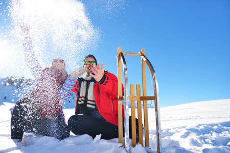 palle di neve: Carefree happy young couple having fun together in snow.