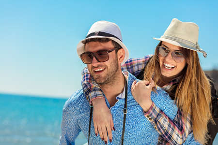 holidays, vacation, love and friendship concept - smiling couple having fun Stock Photo