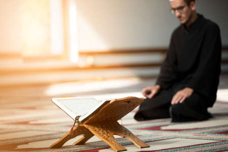 Religious muslim man praying inside the mosque Stockfoto