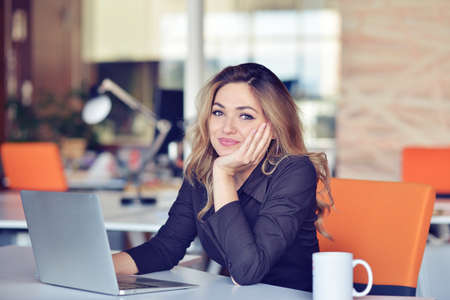Young busy beautiful latin business woman suffering stress working at office computer