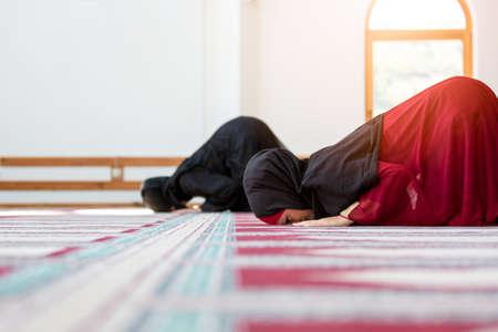 Two Muslim women praying