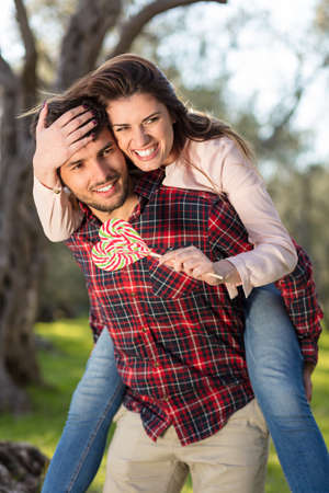 Portrait of a happy young couple in the nature hugged together