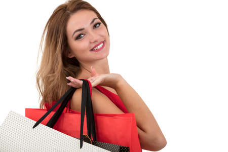 release: Shopping woman holding bags, isolated on white studio background Stock Photo