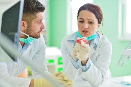 Dental prosthesis, dentures, prosthetics work. Prosthetics hands while working on the denture