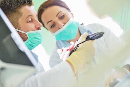 palate: Dental prosthesis, dentures, prosthetics work. Prosthetics hands while working on the denture
