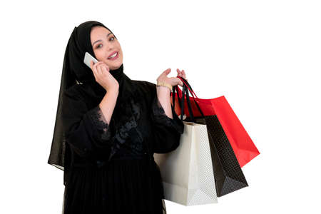 Arabian woman carrying shopping bags isolated on white Stock Photo