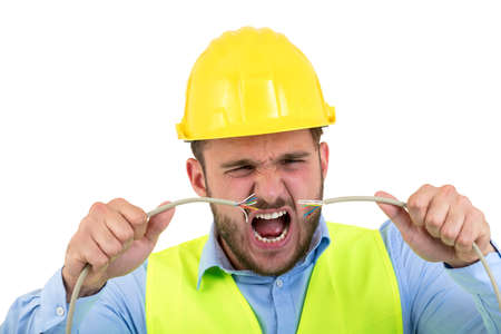 Portrait of crazy electrician over white background