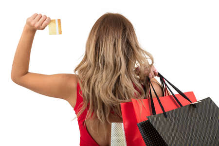 Back view of woman carrying shopping bags on shoulder isolated on white background with text area