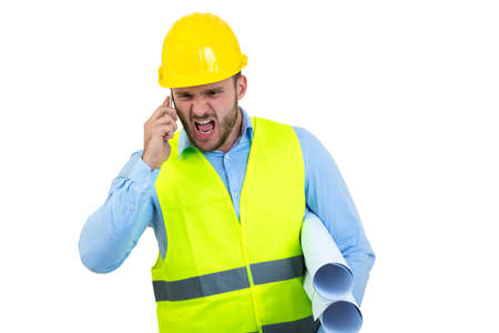 Angry upset young construction engineer yeling at the phone