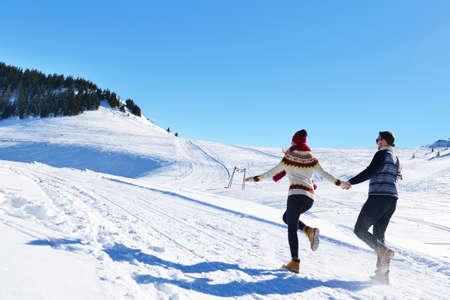 Couple having fun running down slope Stock Photo
