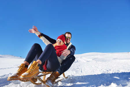 romantic winter scene, happy young couple having fun on fresh show on winter vacatio, mountain nature landscape Фото со стока