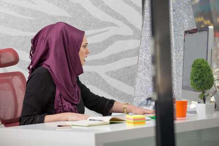 modern female Arabian office worker in office 免版税图像