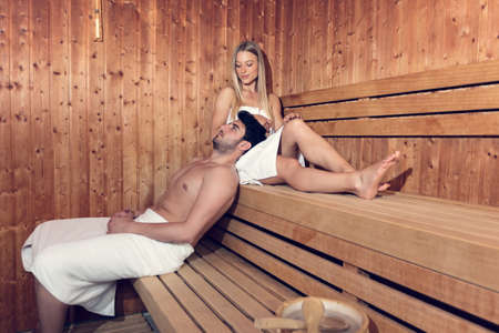 Happy couple enjoying the sauna together at the spa 스톡 콘텐츠