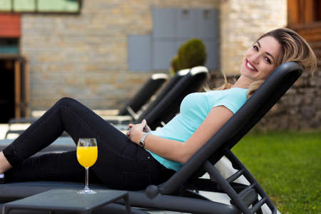 woman relaxing on lounger in the garden