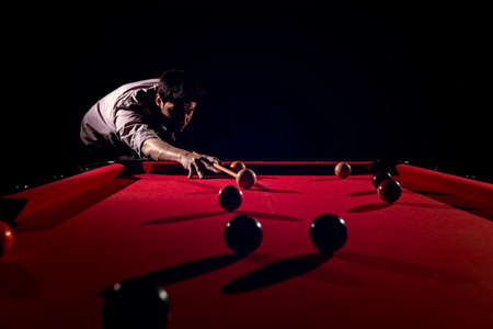 A man with a beard plays a big billiard. Archivio Fotografico