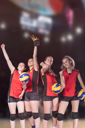 Woman volleyball Players celebrating victory and gold medal