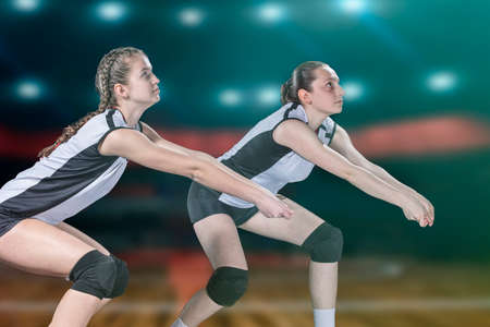Female professional volleyball player on volleyball court