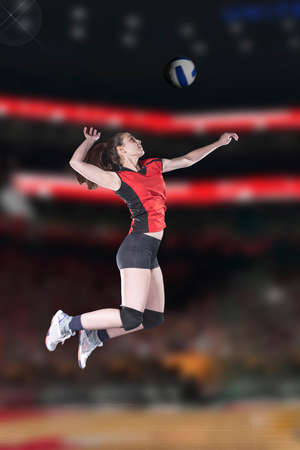 Female volleyball players jumping close-up on vollayball court. Stock Photo