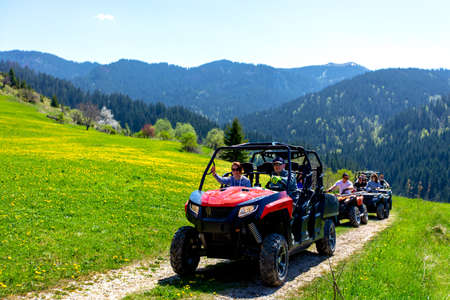A tour group travels on ATVs and UTVs on the mountains Imagens - 102719408