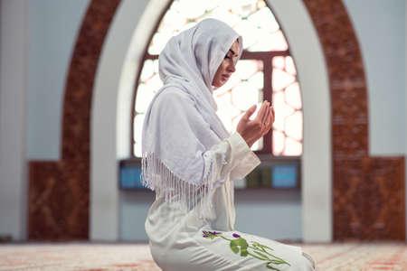 Arabic Young muslim woman praying in mosque