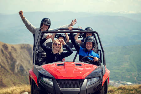 Friends driving off-road with quad bike or ATV and UTV vehicles 스톡 콘텐츠