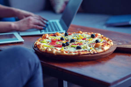 Mock up freelancer workplace. Tablet PC, cell phone and pizza. Top view image. Fast pizza delivery Stock Photo - 106895207