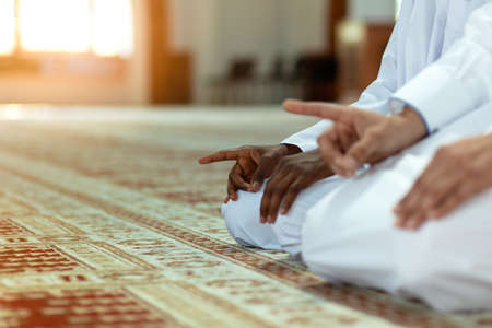 Two religious muslim man praying together inside the mosque Stock Photo - 106895209