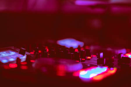 Dj mixes the track in the nightclub at party. DJ hands in motion Stock Photo - 106895210
