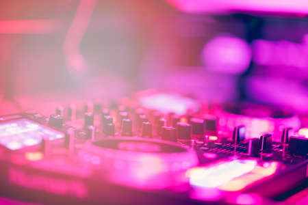 Dj mixes the track in the nightclub at party. DJ hands in motion Stock fotó