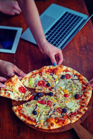 Mock up freelancer workplace. Tablet PC, cell phone and pizza. Top view image. Fast pizza delivery Stock Photo - 106895435