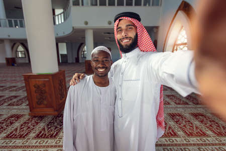 Two Arabis young men love friends selfie with smartphone.