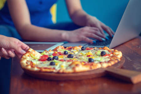 Mock up freelancer workplace. Tablet PC, cell phone and pizza. Top view image. Fast pizza delivery Stock Photo - 106895612